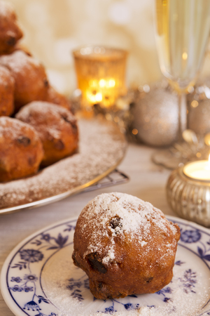dutch culture: Champagne and Oliebollen, traditional Dutch pastry for New Years Eve.