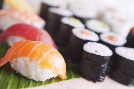 lit collection: Close-up of various Japanese sushi. Photographed with a shallow depth of field.