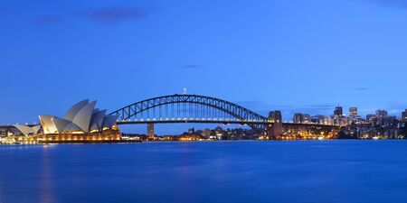 sydney opera house: The Harbour Bridge, Sydney Opera House and Central Business District of Sydney. Photographed at dawn. Stock Photo