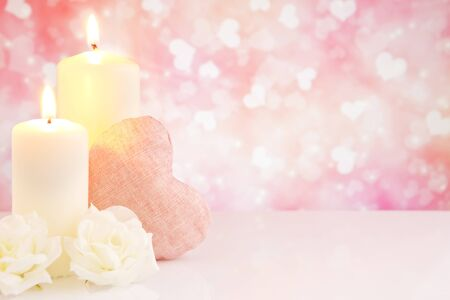 Valentines hearts, candles and roses with a bright glittering background.