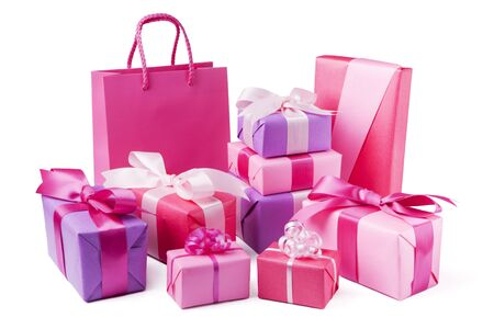 white ribbon: A collection of pink and purple Valentines gifts with satin ribbons. Stock Photo