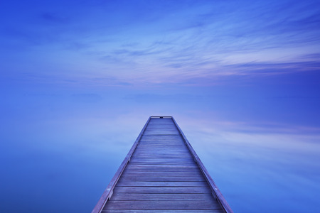 jetty: A small jetty on a still lake on a quiet morning at dawn, near Amsterdam in The Netherlands. Stock Photo