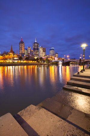 princes street: The skyline of Melbourne, Australia with Flinders Street Station and the Princes Bridge from across the Yarra River at night.