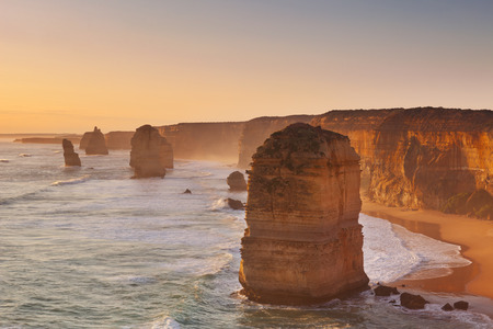 cliff edge: The Twelve Apostles along the Great Ocean Road, Victoria, Australia. Photographed at sunset.