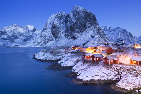 Traditional Norwegian fisherman's cabins, rorbuer, on the island of Hamny, Reine on the Lofoten in northern Norway. Photographed at dawn in winter. Reklamní fotografie - 54068665