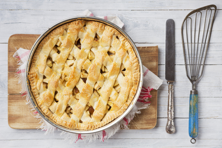 directly above: Homemade Dutch apple pie on a rustic table. Photographed from directly above.