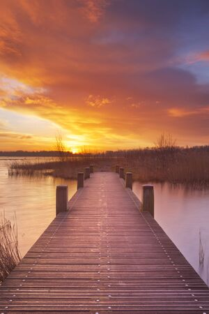 saturated color: Spectacular sunrise over a lake near Amsterdam in The Netherlands.