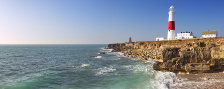 naturally: The Portland Bill Lighthouse on the Isle of Portland in Dorset, England on a sunny day. Stock Photo
