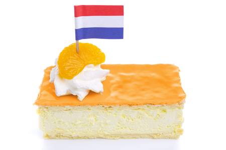 traditional celebrations: An orange tompouce, traditional Dutch pastry, on a white background. The orange icing on the tompouce is typical for Kings Day (Kongingsdag) on April 27th.