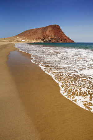 non la: Playa la Tejita Beach and Montana Roja on Tenerife, Canary Islands, Spain on a sunny day. Stock Photo