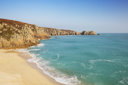 porthcurno: A beautiful beach with turquoise water at Porthcurno in Cornwall, England. Stock Photo