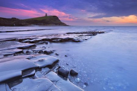 kimmeridge: Last light over the rocky beach of Kimmeridge Bay on the south coast of England. Stock Photo