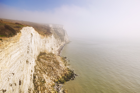 dover: The white cliffs of Dover on a beautiful foggy morning, photographed from above. Stock Photo