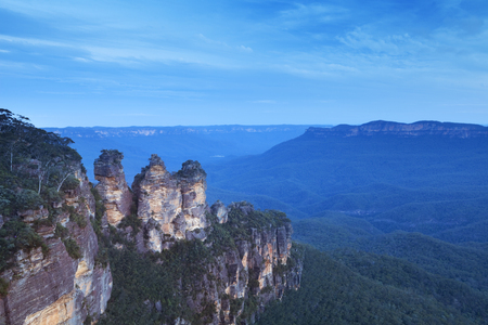 The Three Sisters rock formation in the Blue Mountains, New South Wales, Australia. Photographed at dusk. Stock Photo