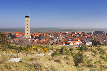 West-Terschelling village with the Brandaris lighthouse on the island of Terschelling in The Netherlands on a bright and sunny day. Reklamní fotografie - 59479678