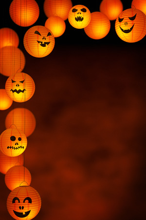digitally generated image: A collection of Halloween paper lanterns on a background with plenty of copy space.