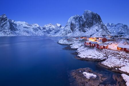 rorbuer: Traditional Norwegian fishermans cabins, rorbuer, on the island of Hamn�y, Reine on the Lofoten in northern Norway. Photographed at dawn in winter.