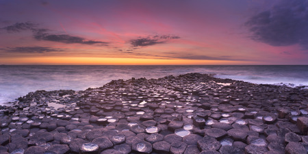 basalt: Sunset over the basalt rock formations of Giants Causeway on the north coast of Northern Ireland.