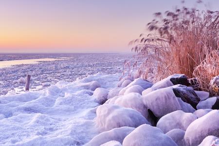 markermeer: Sunrise over a frozen lake Marken in The Netherlands.