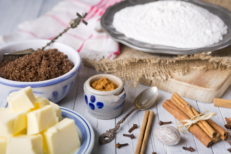 speculaas: All ingredients for pepernoten or kruidnoten, a Dutch delicacy for Dutch holiday Sinterklaas. Stock Photo