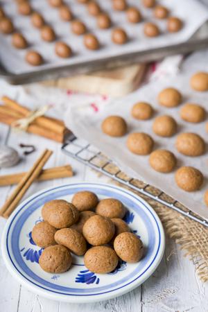 sinterklaas: Homemade pepernoten or kruidnoten, a Dutch delicacy for Dutch holiday Sinterklaas. Stock Photo