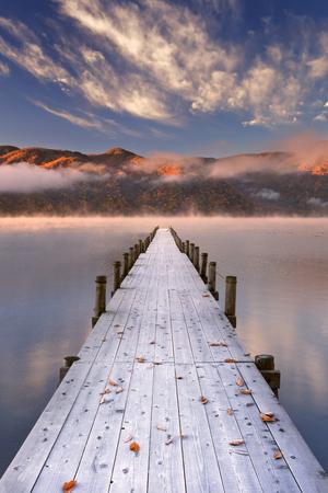 Lake Chuzenji (Chuzenjiko) near Nikko in Japan. Photographed on a beautiful still morning in autumn at sunrise. Stock Photo