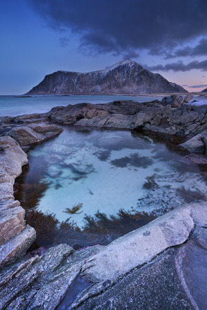 urban scene: The rocky beach of Skagsanden on the Lofoten in northern Norway, photographed at dawn in winter.
