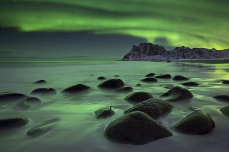 coastlines: The aurora borealis over Uttakleiv beach on the Lofoten in northern Norway in winter. Stock Photo