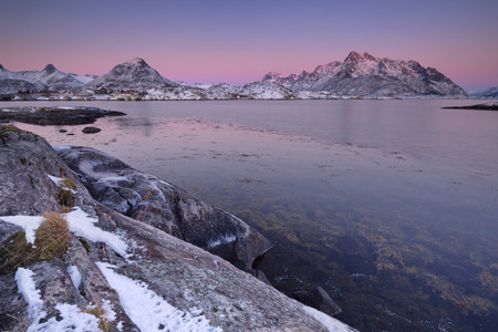 Mountains and ocean on the Lofoten in northern Norway at sunset in winter. Stock Photo