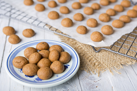 field depth: Homemade pepernoten or kruidnoten, a Dutch delicacy for Dutch holiday Sinterklaas. Stock Photo