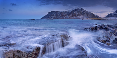 archipelago: The rocky beach of Skagsanden on the Lofoten in northern Norway, photographed at dawn in winter.