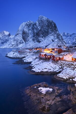 oceanarium: Traditional Norwegian fishermans cabins, rorbuer, on the island of Hamn�y, Reine on the Lofoten in northern Norway. Photographed at dawn in winter.