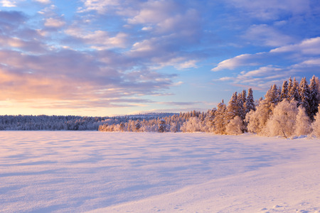 A beautiful lake in Finnish Lapland in winter. Photographed at � ijäjärvi at sunset. Stock Photo