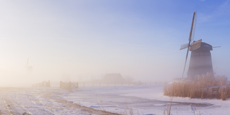 schermerhorn: Traditional Dutch windmill on a beautiful frosty and foggy morning.