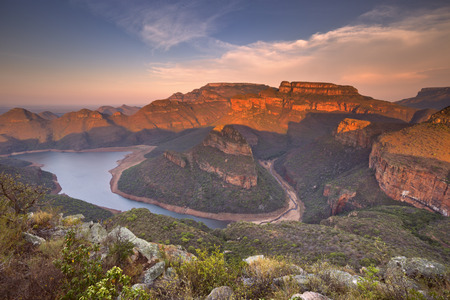 high view: View over the Blyde River Canyon and the Three Rondavels in South Africa at sunset. Stock Photo