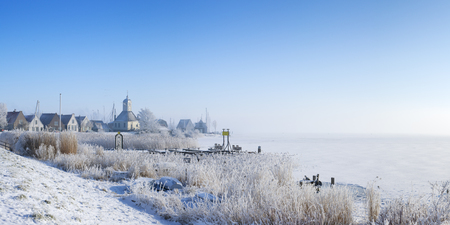 The beautiful village of Durgerdam in The Netherlands along the Markermeer (Lake Marken). Photographed in the morning after one of the coldest nights recorded in history of The Netherlands at a temperature of -20C.
