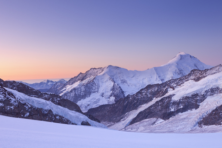 Dawn at Jungfraujoch in Switzerland on a clear morning.