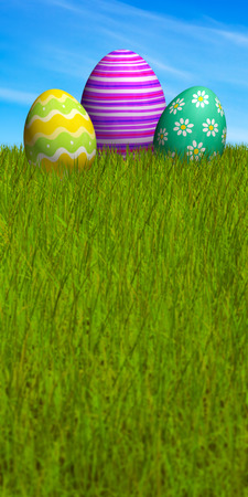 Decorated Easter eggs lying in the grass.