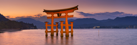 non urban scene: The famous torii gate of the Itsukushima Shrine on Miyajima. Photographed at sunset.