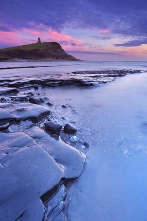 Last light over the rocky beach of Kimmeridge Bay on the south coast of England. Stock Photo