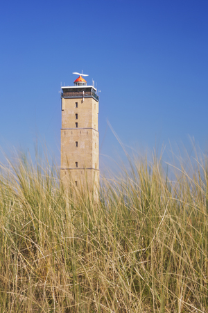 The Brandaris lighthouse on the island of Terschelling in The Netherlands on a bright and sunny day. Stock Photo