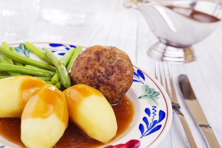 A plate with potatoes, meat and vegetables; a typical Dutch meal at dinnertime.