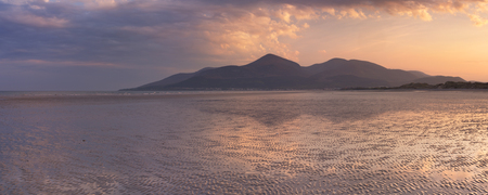 The Mourne Mountains in Northern Ireland at sunset, photographed from Murlough Beach. Stock Photo