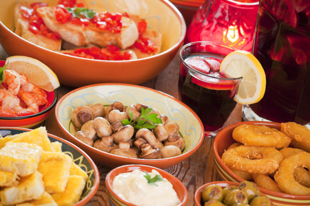 calamares: A table filled with all sorts of Spanish tapas and sangria.