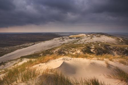 Dark storm clouds over the dunes of the Dutch island Terschelling.