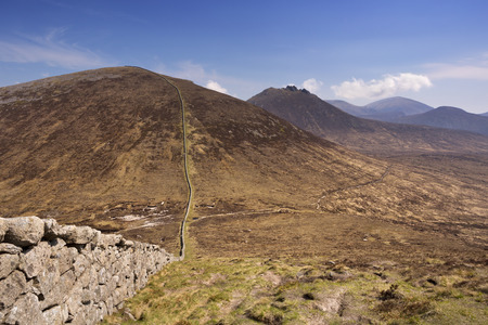 The Mourne Wall in the Mourne Mountains in Northern Ireland on a sunny day.