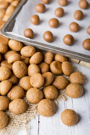 Homemade pepernoten or kruidnoten, a Dutch delicacy for Dutch holiday Sinterklaas. Stock Photo