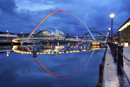 The Gateshead Millennium Bridge over the river Tyne in Newcastle upon Tyne, England.