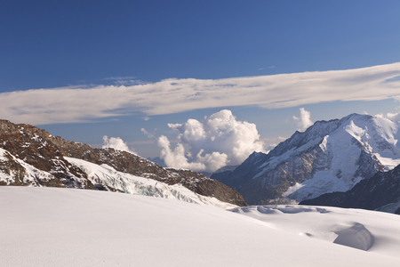 View from Jungfraujoch in Switzerland on a sunny day. Stock Photo