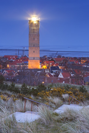 The Brandaris lighthouse in West-Terschelling on the island of Terschelling in The Netherlands at night.